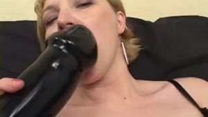 Clothed woman plugs cute with a huge strapon which inspires every take of her dildo