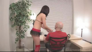 Pretty girl was gently sucking her sexual therapist's dildo while kneeling in front of him