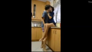 Gorgeous brunette with big tits is getting doublefucked in the kitchen, in the morning