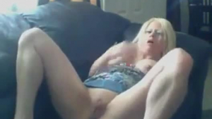 Lusty blonde woman with big boobs is gently sucking a dildo while working in a local bar
