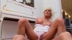 Smashing mature blonde, Sonia is having sex with a younger guy who came to her place