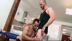 A horny dude was sucking a horny bitch's big, firm tits, while they were in this massage room