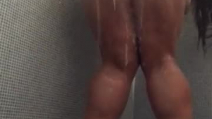 Buxom Eva toying in the shower