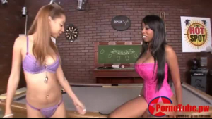Glam brunette girls licking each other on table
