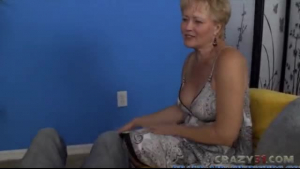 Nasty blond granny gives an amusing handjob