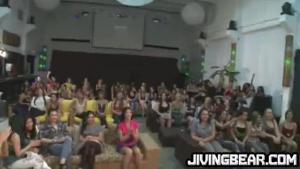 A chubby brunette jerking a huge cock