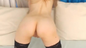 Fit blonde is taking a large pink toy up her ass, while in front of the camera