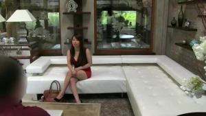 An Asian babe fucking on a sofa
