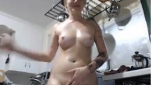 Voluptuous woman is slowly getting naked in the kitchen, while holding the camera in her hands