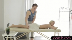 Big titted, blonde woman, Nyomi is fucking her lesbian masseuse, while on the massage table