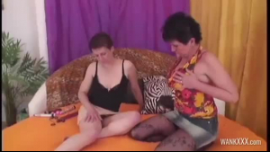 Mature blonde woman is sucking her lesbian friend's hard meat stick and getting it inside her