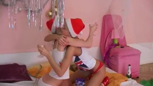 Nasty milf and gentle teen are pampering each other in a huge bed and playing with sex toys