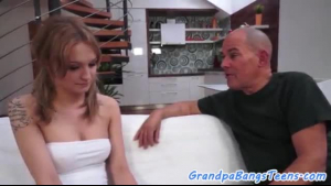 Busty blonde prepares to have her anus pried open by a senior