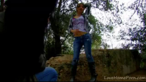 Pretty teen strips and poses in the forest
