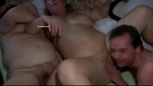 Chubby granny spreads naked on bed