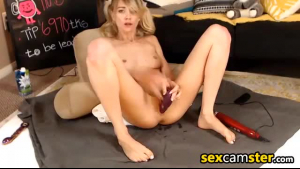 Pretty blonde girl with a red nail polish is enjoying a blowjob and fucking her friend