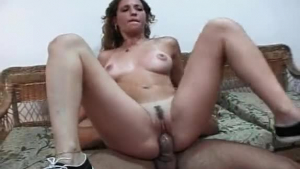 Latin babe spread her legs and got fucked from the back with a strap- on