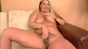 Orgasmic blonde with a nice big hitachi belt nailed in a massage room