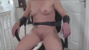 Pillow tied blonde is lying on the cold bed, while her partner is licking and rubbing her ass