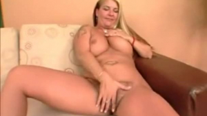 Blonde babe with a nice, round ass is sucking a black man's hard rod
