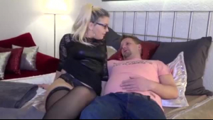 Tattooed blonde swinger giving head and getting fucked from behind