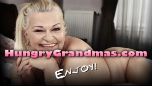 Charming granny in red dress lifted her leg high and started rubbing one big, hard dick
