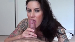 Tattooed chick, Kacey Jordan is riding a double- dildo while wearing her best erotic lingerie.