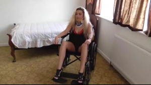 Pretty TS wheelchair worker Kitty in latex costume and fishnet