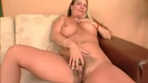 Blonde with huge natural breasts spreads her huge forearms and shows her boobs to the camera