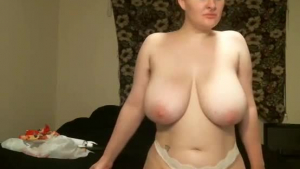 Blonde amateur with perfect tits posing nude on bed.