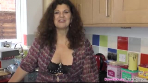 Sexy mature woman in laundry goods